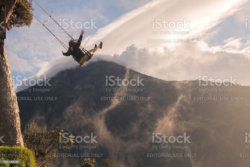 Silhouette Of An Young Happy Woman On A Swing stock photo