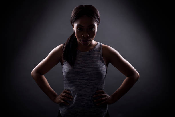 Silhouette of Angry Black Woman or Athlete Intense Pose stock photo