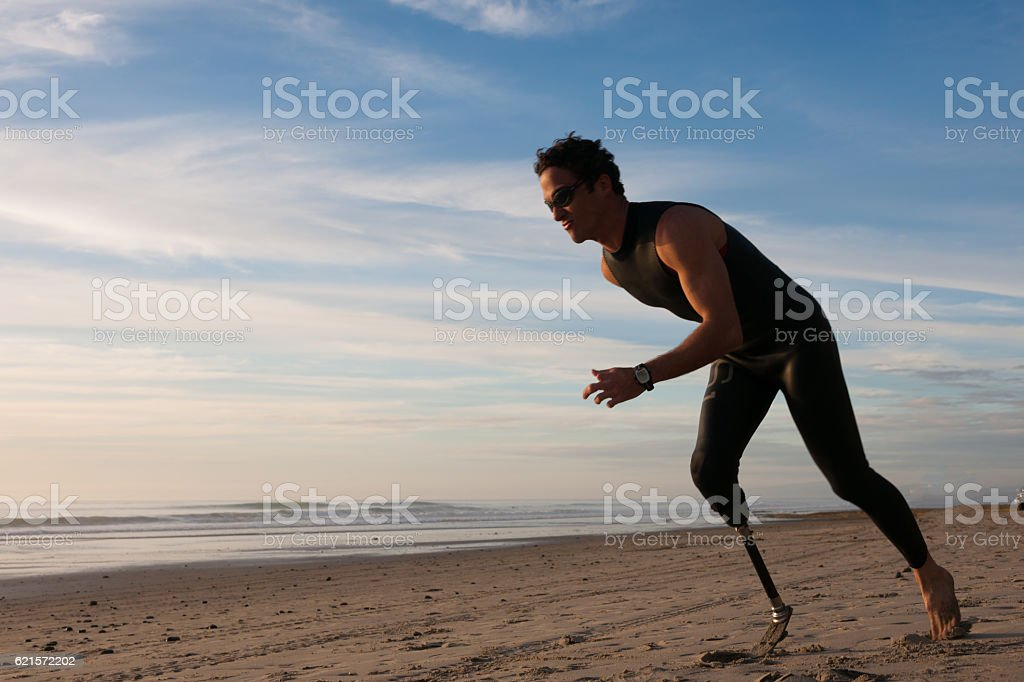 Silhouette Of Athlete With Prosthetic Leg On The Beach stock photo