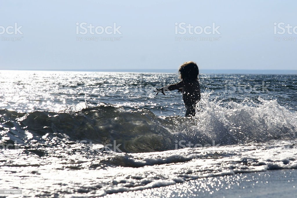 silhouette of baby in the sea royalty-free stock photo