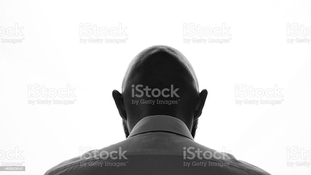 Silhouette of bald man stock photo