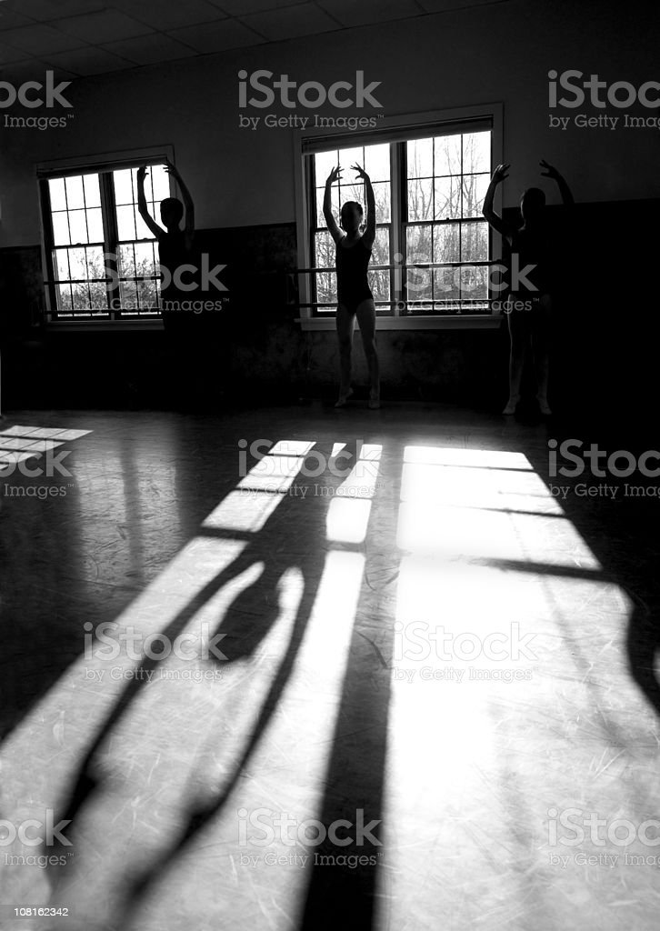 Silhouette of Ballet Dancers and the Shadows royalty-free stock photo