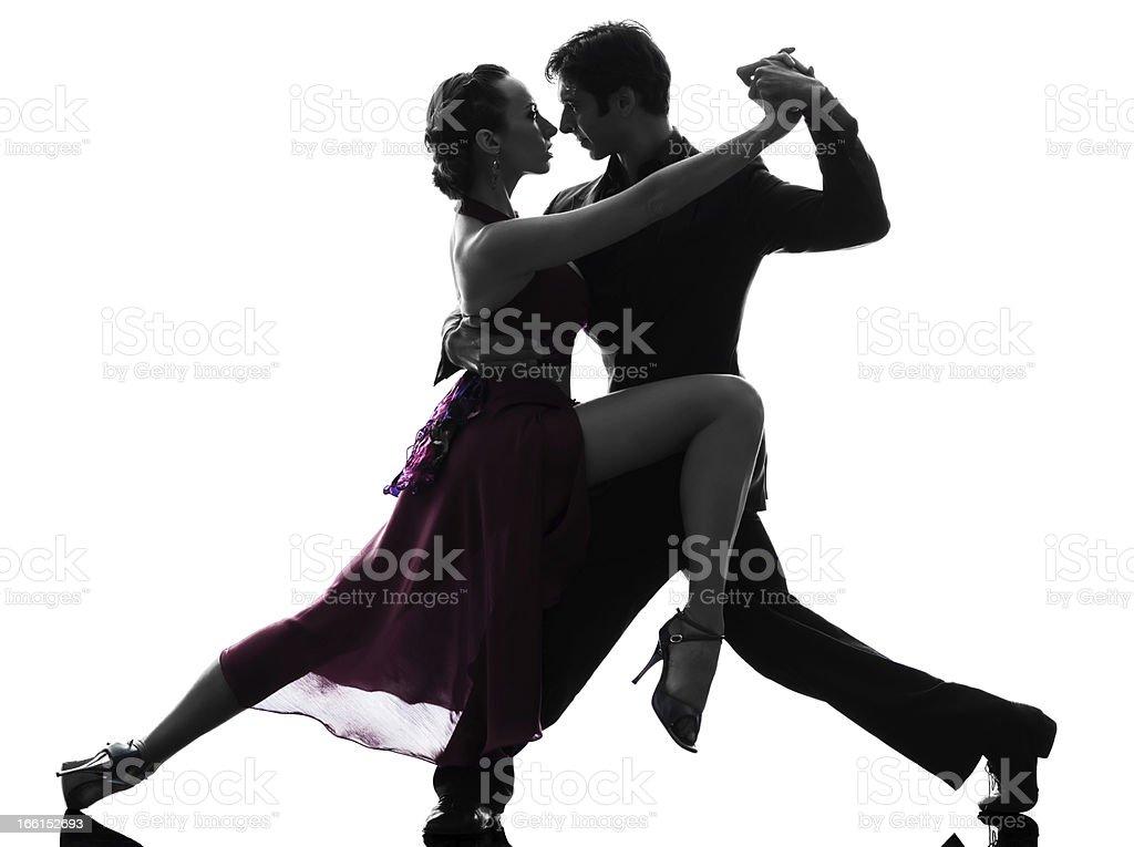 Una Pareja Hombre Mujer de silueta bailarines de baile de bailar un tango - foto de stock