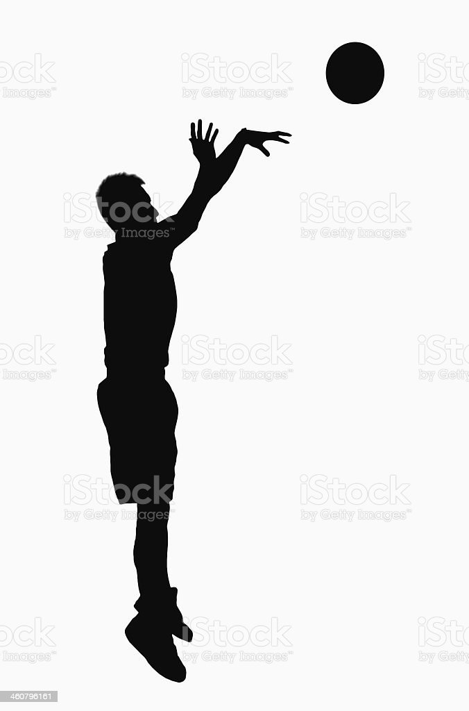 Silhouette of basketball player jumping. stock photo