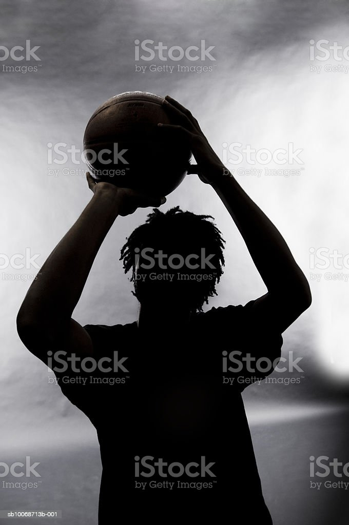 Silhouette of basketball player foto de stock libre de derechos