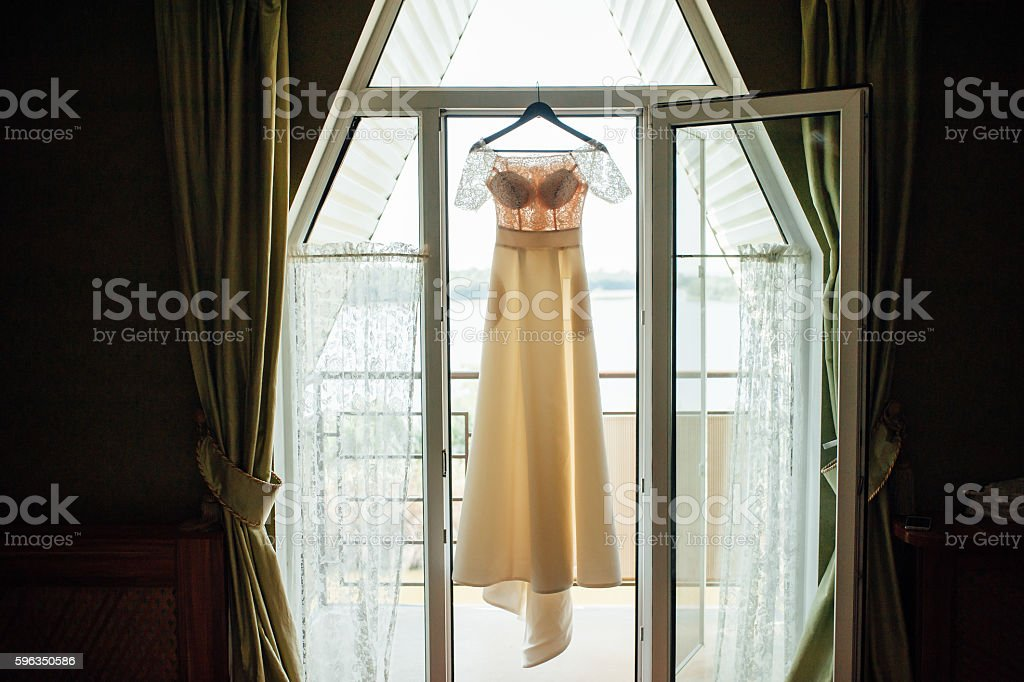 silhouette of beige lace vintage wedding dress royalty-free stock photo