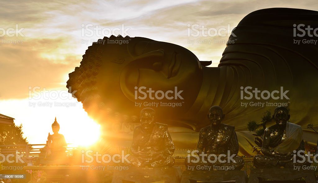 Silhouette of big Buddha statue over sunrise at Songkhla, Thailand stock photo