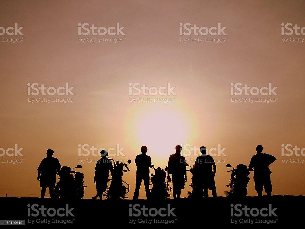 Silhouette of bike riders stock photo