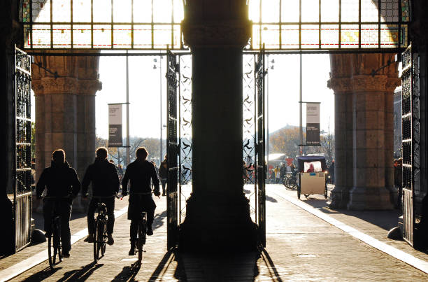 Silhouette of Bikers riding in Amsterdam Dramtatic silhouette of Bikers riding fast on the Rijkmuseum passage by MuseumPlein in Amsterdam. This undepass was reopened to the public in 2013. museumplein stock pictures, royalty-free photos & images