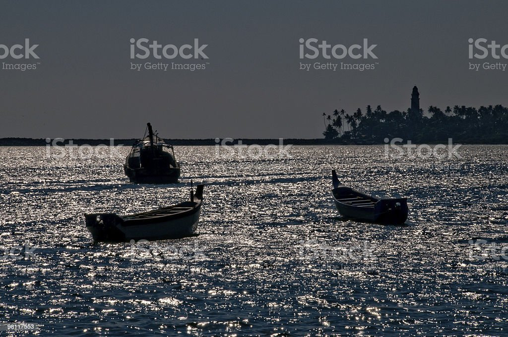 Silhouette of boats in midafternoon. royalty-free stock photo