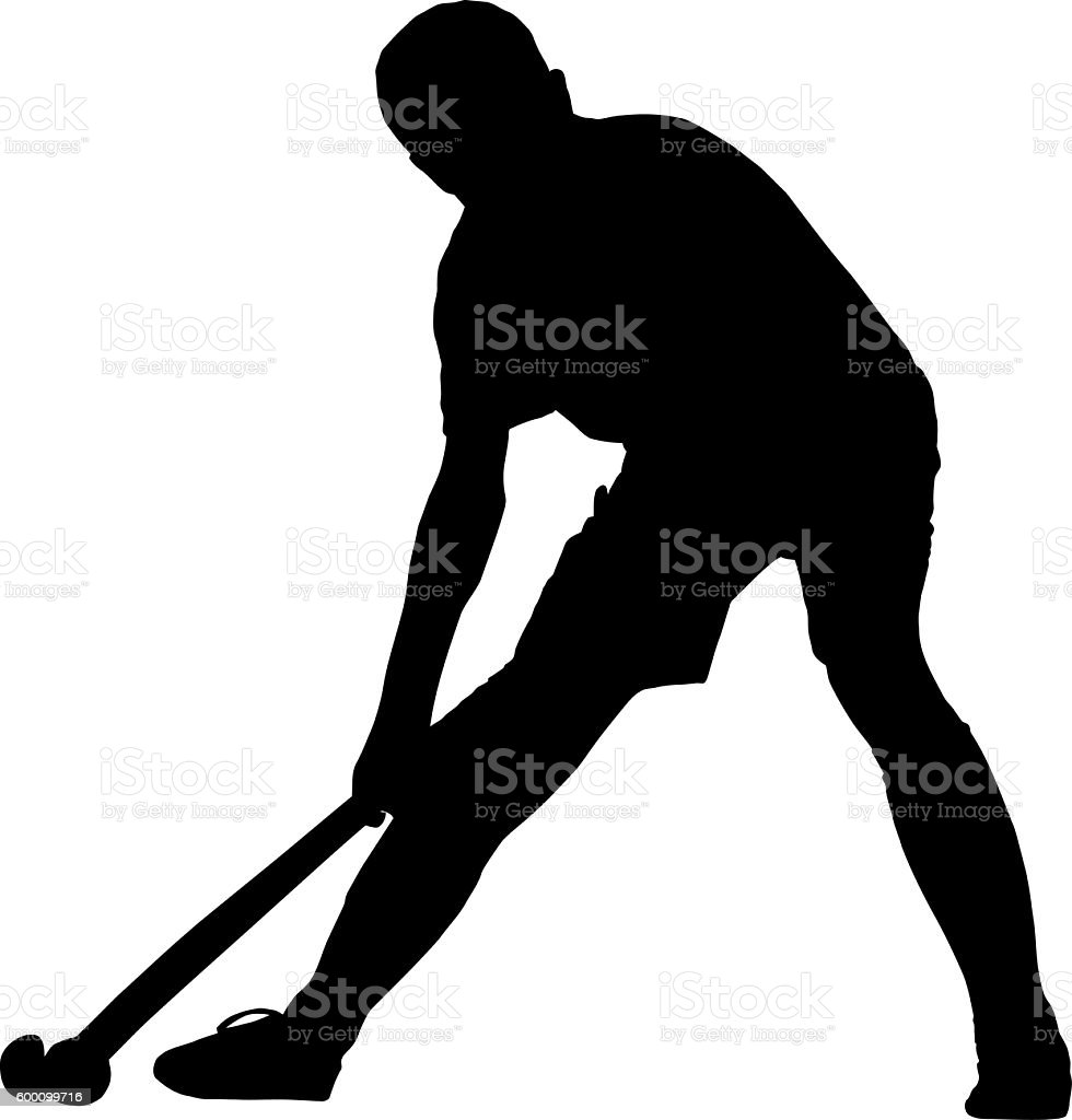 Silhouette of boy hockey player playing corner ball stock photo