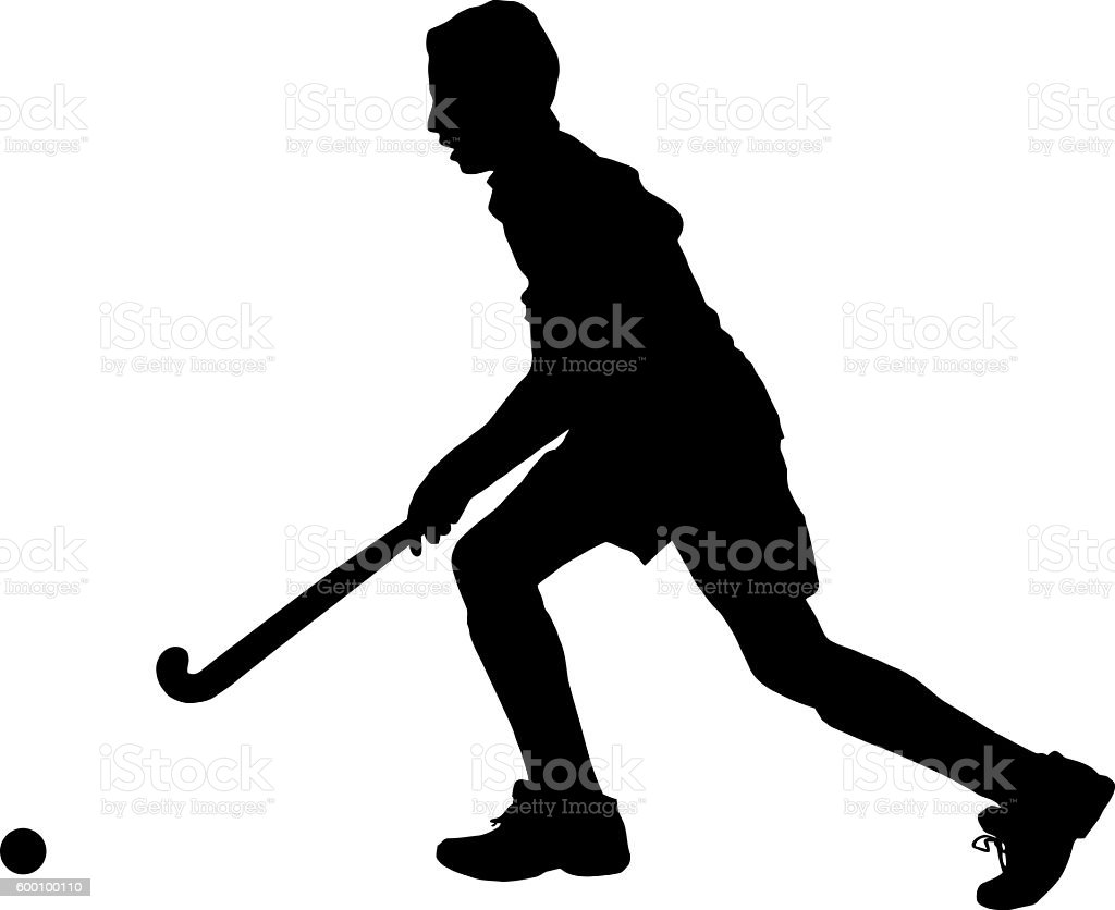 Silhouette of boy hockey player running with ball stock photo