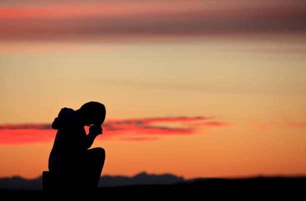 Silhouette of Boy Praying