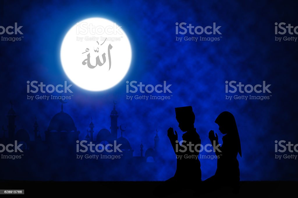 Silhouette of boy praying . stock photo