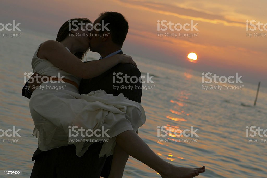 Silhouette of bride and groom at mexican sunset wedding royalty-free stock photo