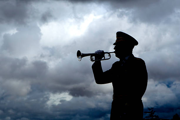 Silhouette of bugle player. stock photo