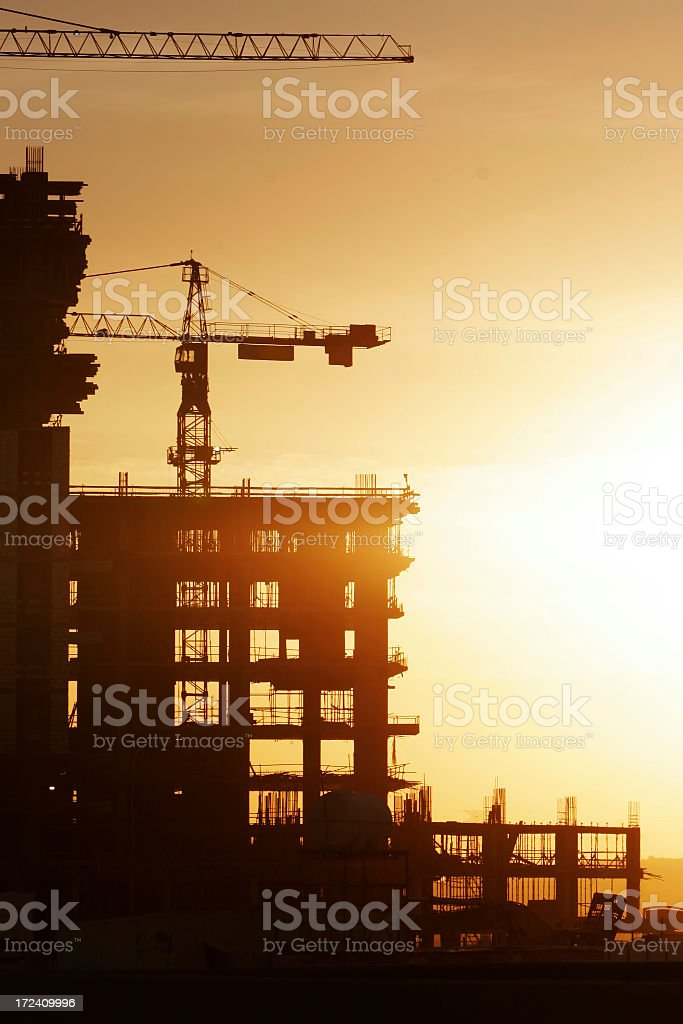 Silhouette of building being constructed in the sunrise royalty-free stock photo