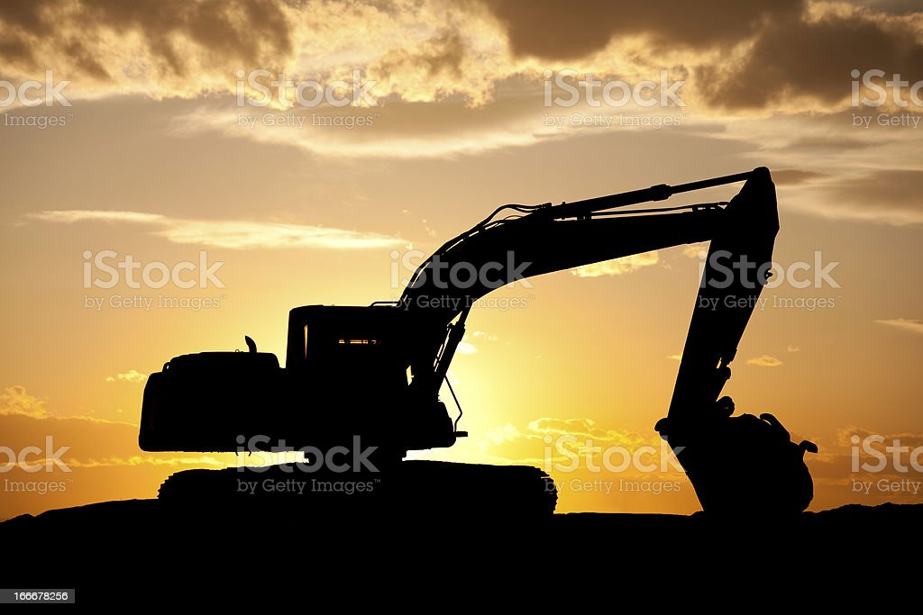 Silhouette of Bulldozer at a Construction Site stock photo