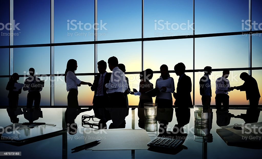 Silhouette of business people in conference room stock photo