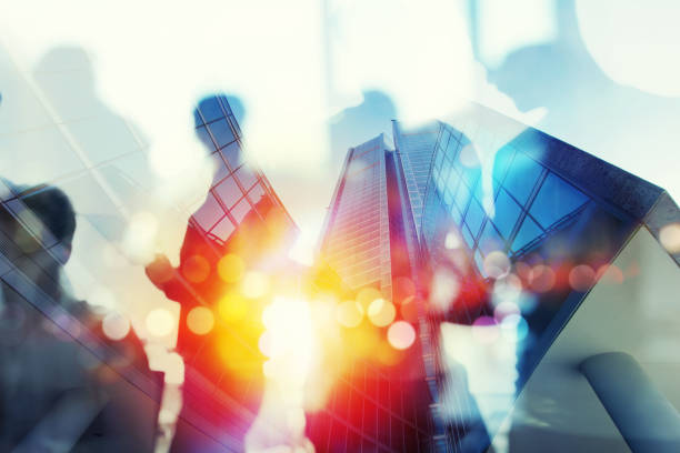 Silhouette of business people work together in office. Concept of teamwork and partnership. double exposure with network effects - foto stock