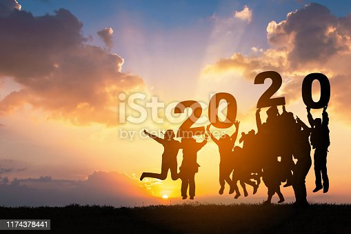 istock Silhouette of Business teamwork hands up and jump to the beautiful golden sky from text 2020 background .The concept of business sucess,victory,achieve target goal,busness growth. 1174378441