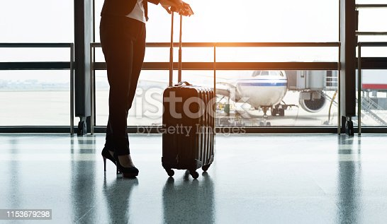 istock Silhouette of business traveler waiting for the flight 1153679298