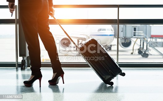istock Silhouette of business traveler waiting for the flight 1153679303