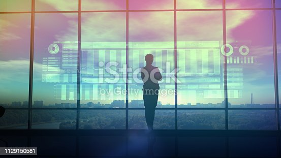 850852928istockphoto Silhouette of business woman and stock exchange infographics 1129150581