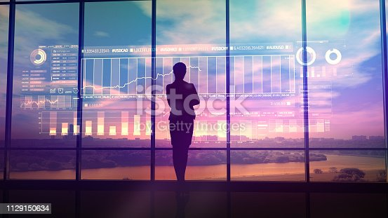 850852928istockphoto Silhouette of business woman and stock exchange infographics 1129150634