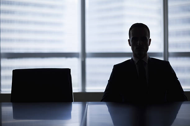 Silhouette of businessman in office meeting room stock photo