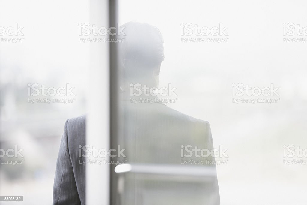 Silhouette of businessman outdoors royaltyfri bildbanksbilder