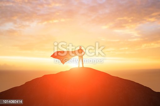 silhouette of super businessman back to you and look somewhere on the moutain