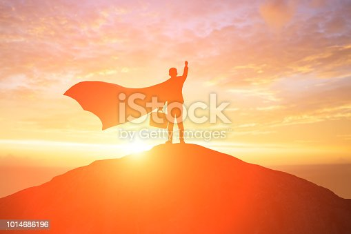 silhouette of super businessman back you and feel excited on the moutain