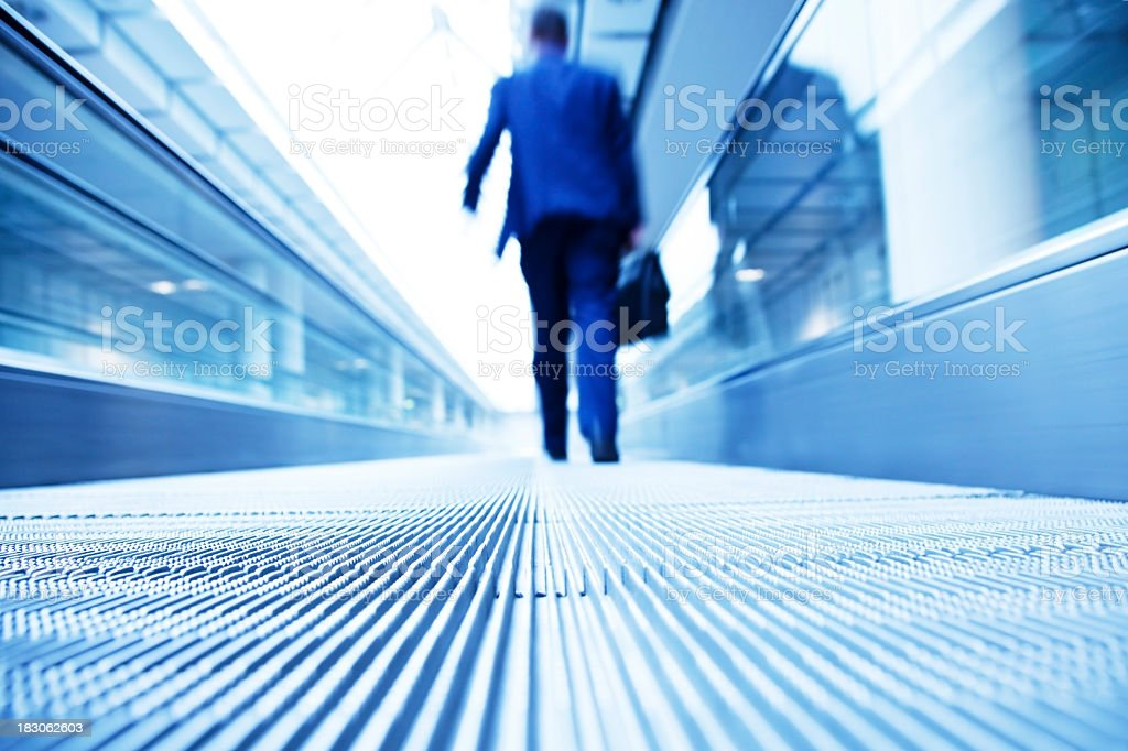 Silhouette of Businessman Travelling on Escalator royalty-free stock photo