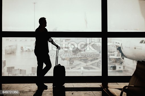 509630674 istock photo Silhouette of businessman waiting for his flight 649701350