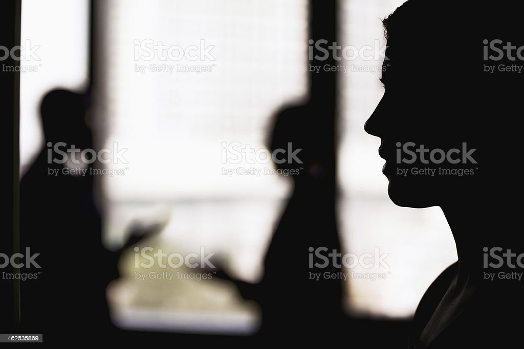 Silhouette of businesswoman with coworkers royalty-free stock photo