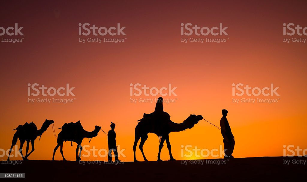 Silhouette of Camel Safari in Desert royalty-free stock photo