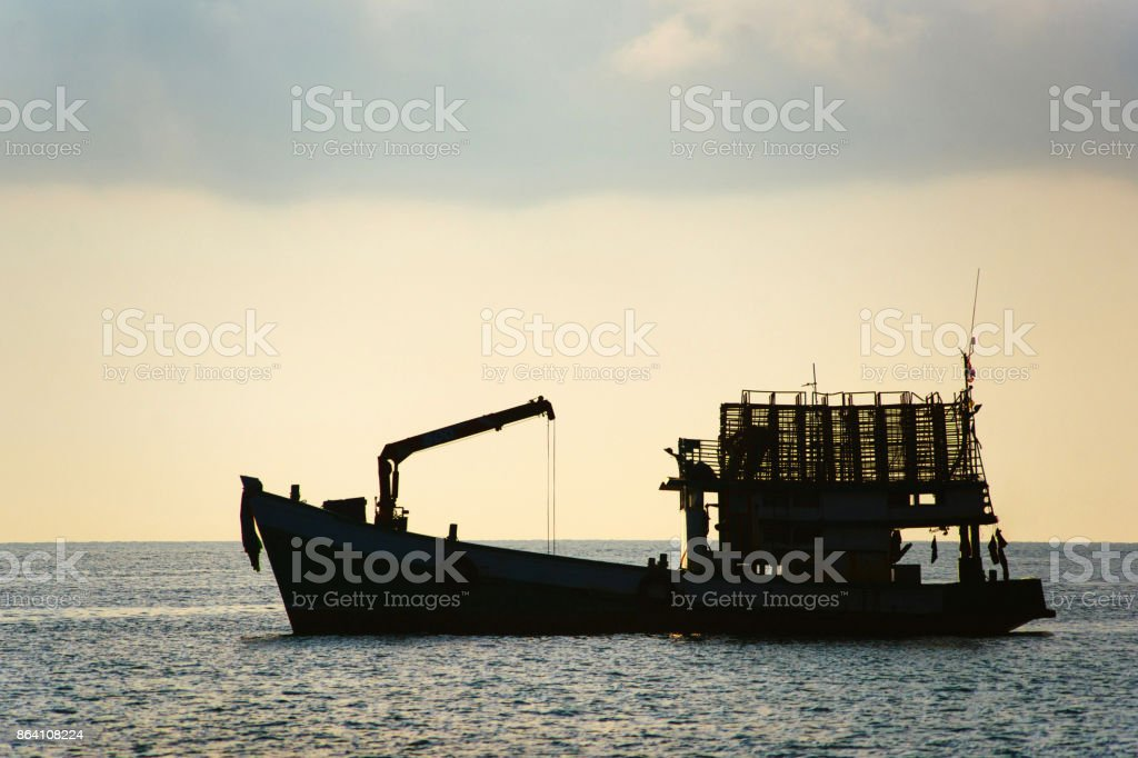 Silhouette of cargo ship royalty-free stock photo
