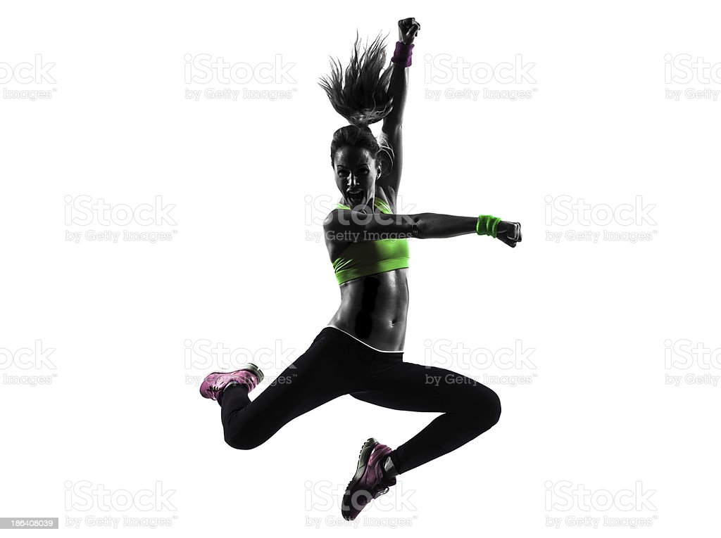 Silhouette of Caucasian woman practicing Zumba stock photo