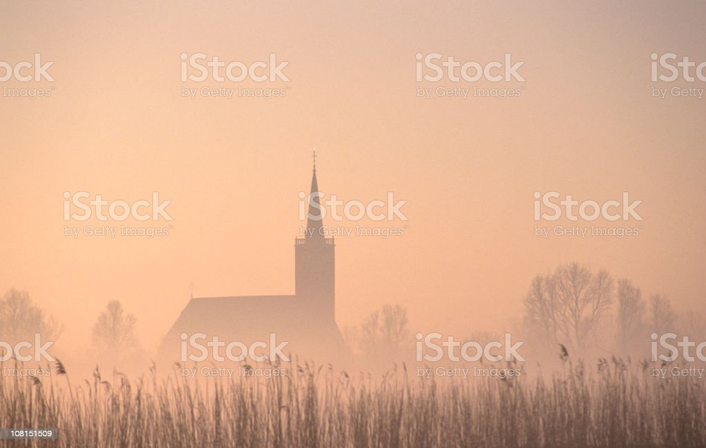 SIlhouette of Church in Fog stock photo
