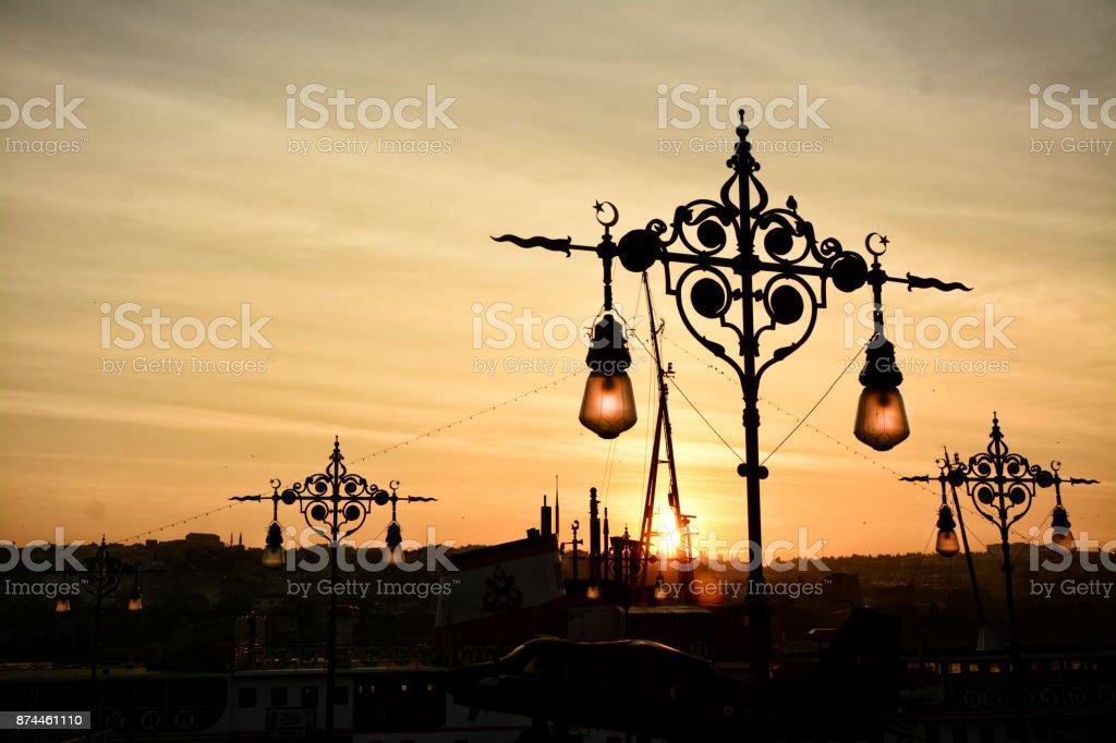 Silhouette of city lantern on the sunset stock photo
