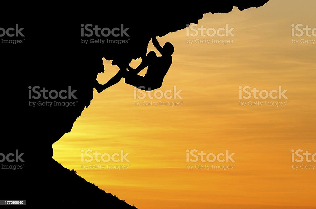 silhouette of climber stock photo