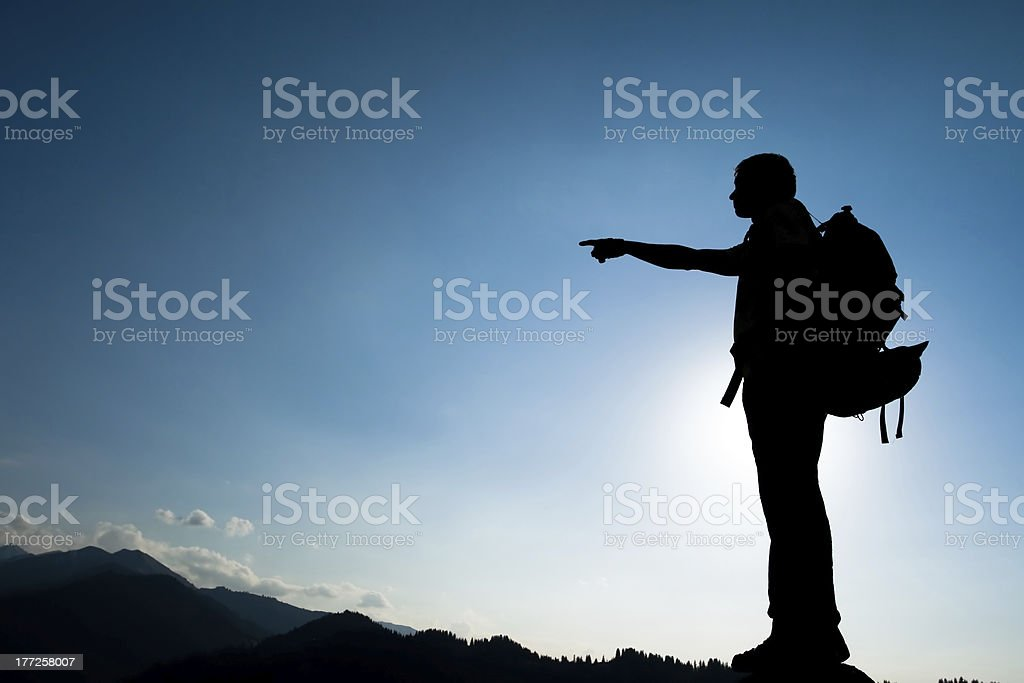 Silhouette of climbing young adult royalty-free stock photo