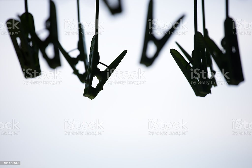 silhouette of clothpins as background. stock photo
