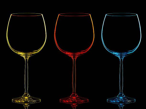 silhouette of color wine glass on black - neon partylebensmittel stock-fotos und bilder