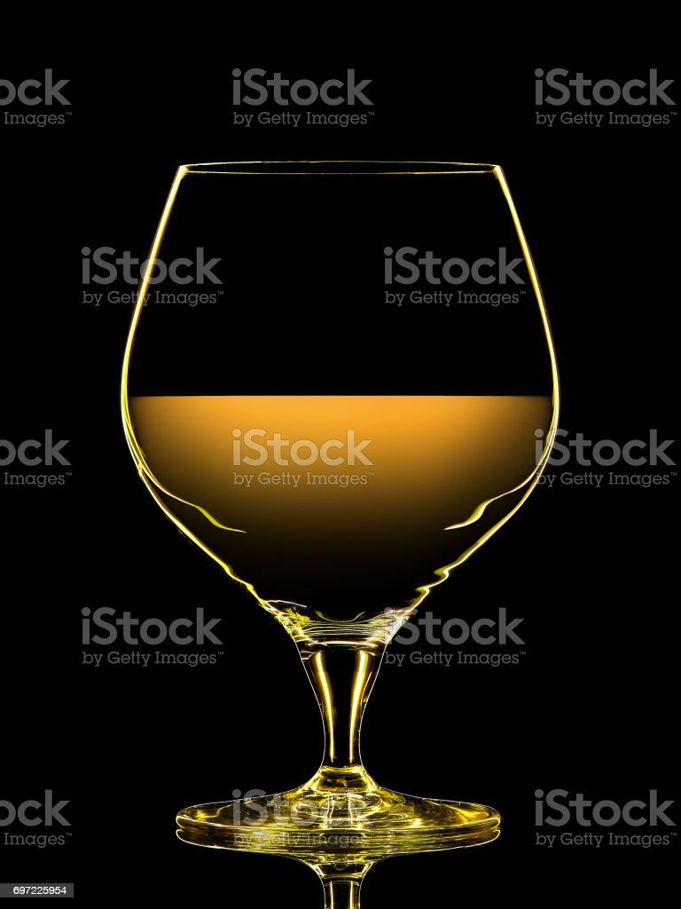 Silhouette of colorful whiskey glass on black stock photo