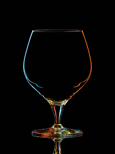 silhouette of colorful whiskey glass with clipping path on black - einladungskarten online gestalten stock-fotos und bilder