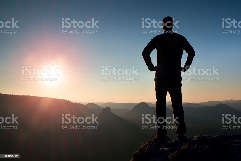 Silhouette of Confident and Man Standing with Hands on Hips, stock photo