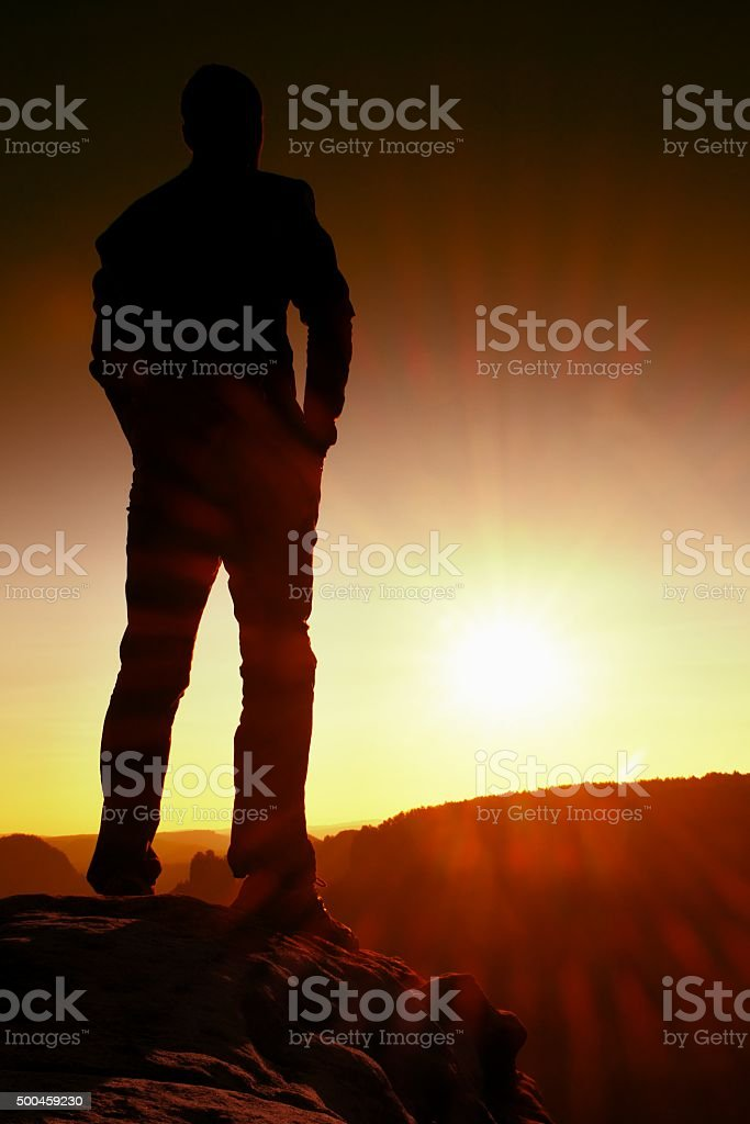 Silhouette of Confident and Powerful Man with Hands on Hips stock photo