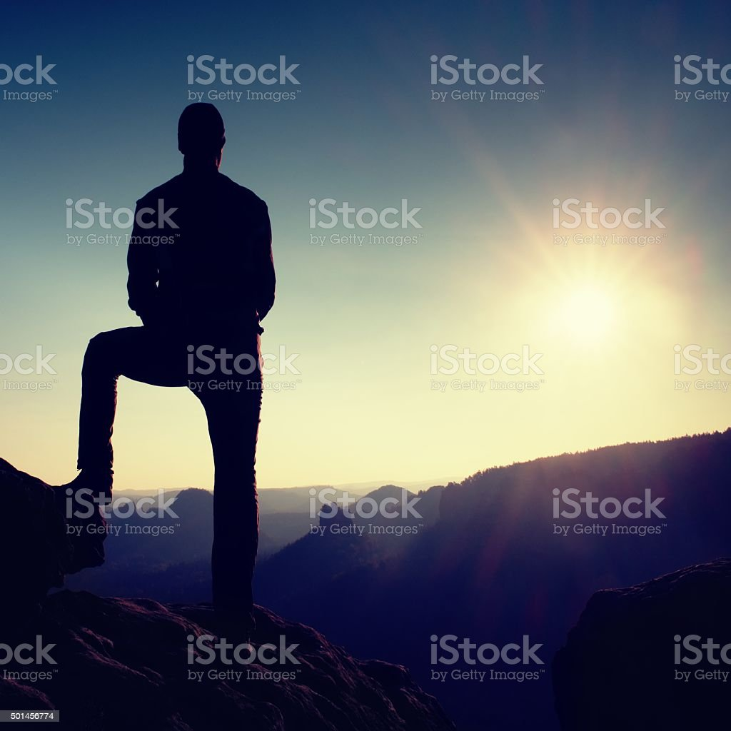 Silhouette of Confident and Powerful Man with Hands on Hips, stock photo